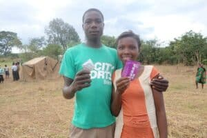 A young couple receives condoms after getting tested for HIV